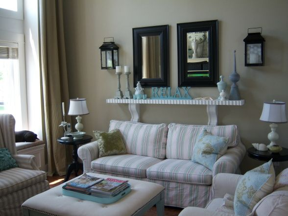 Just beachy living rooms design like the lanterns and shelf over the