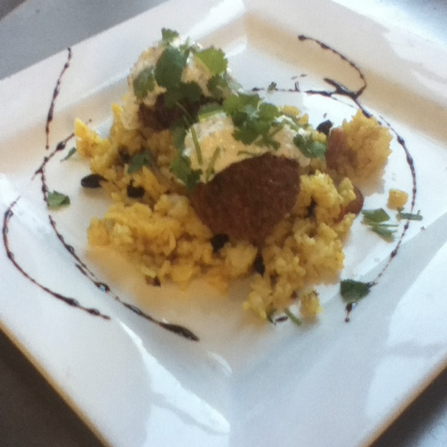 Lamb meatballs with cashew-raisin pilau and raita