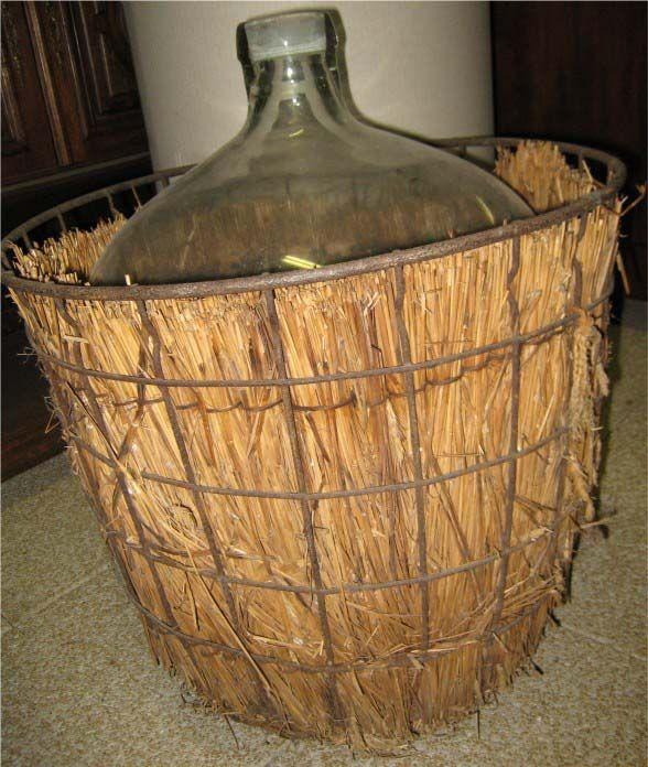 Antique French basket for large wine bottle