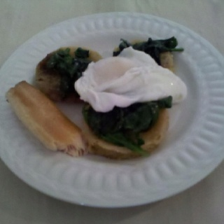 Fried green tomatoes & wilted spinach topped with a poached egg with a ...