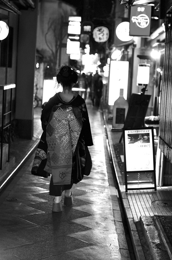 A maiko-san (a geisha in training) going to work in Ponto-cho, a tiny street in Kyoto