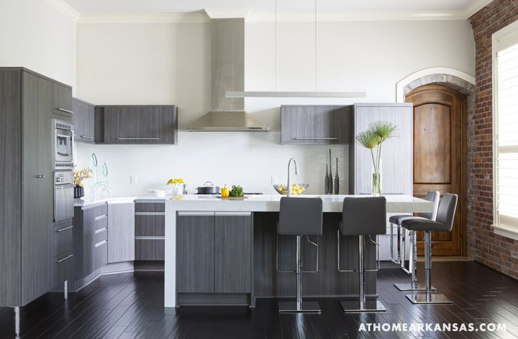 Of the kitchen the room is painted in misty grey by benjamin moore
