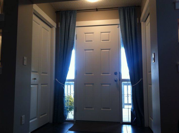 We put curtains above the front door for sidelight coverings. I love ...