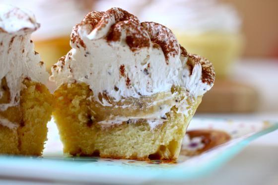 Tiramisu Stuffed Cupcakes - vanilla cupcake with mascaarpone filling, coffee buttercream, dusted with cocoa.