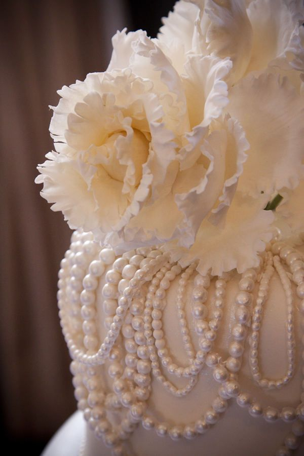 beautiful pearl and flower wedding cake