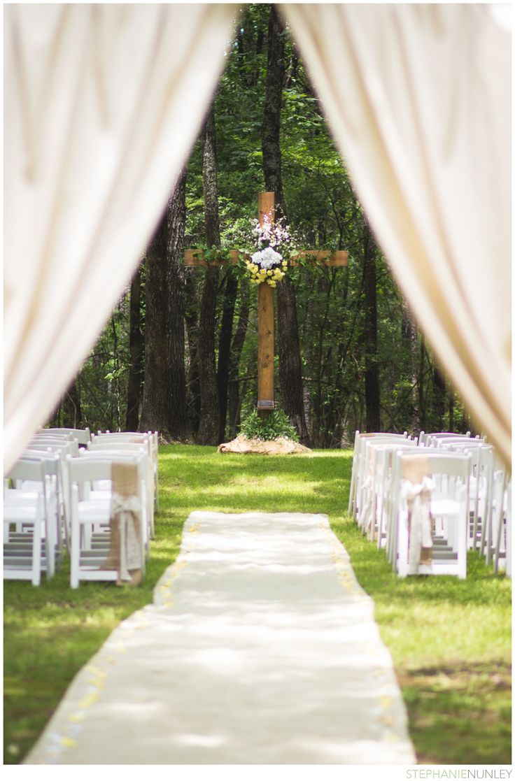 Outdoor Christian wedding ceremony under the cross.