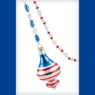 """This beautiful ornament hanger is made with sparkling translucent red, white and blue beads. Attached is a matching frosted white ornament with red strips and white stars in the frosted blue area. Size: 23.75"""" long.    IDEAS FOR HANGING  Hang them from the blinds, curtain rods, window frames, on the wall, rings of a shower curtain, mirrors, banisters and any other place you can think of!"""
