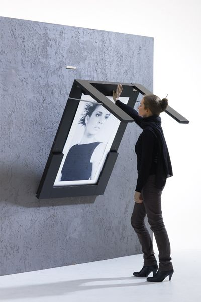 An incredibly brilliant idea - a folding table that stores on the wall as art. Great idea for small spaces.
