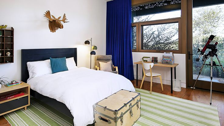 Real Estate Envy: 7 Dreamy Vacation Homes // bedroom, striped rug, trunk, moose head