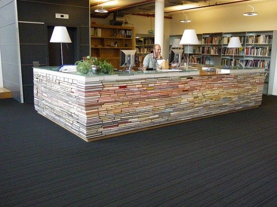 library information desk made out of thousand repurposed books !