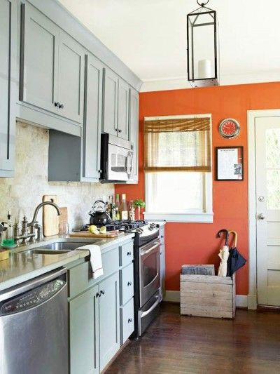 Tangerine accent wall, gray kitchen cabinets  Kitchen Dining Room