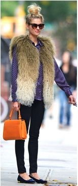 big fur vest, top knot, bright orange bag - yes, yes, yes.