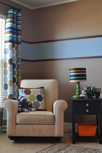 One of the elements of design is repetition.This photo is a good example as the stripe on the wall is repeated in the draperies and lamp shade. The circles are repeated as well.