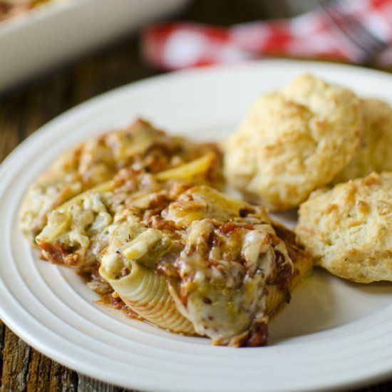 Pasta shells stuffed with vegetables and lots of melted cheese, topped ...