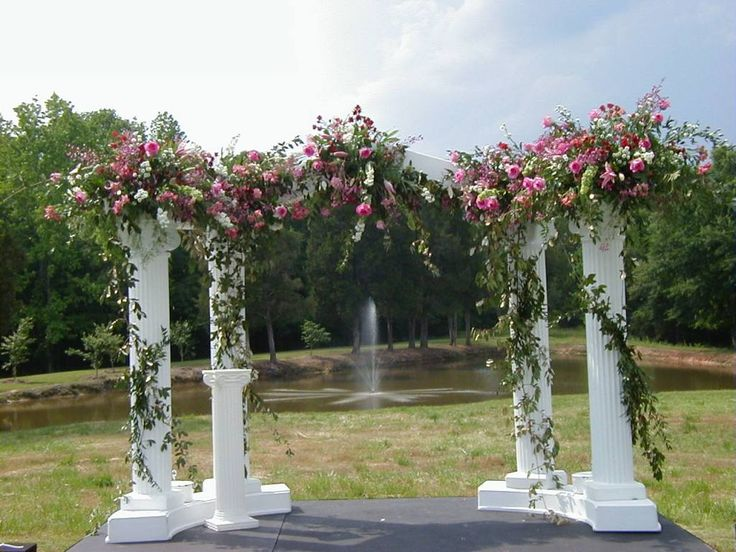 Columns with flowers arch wedding arches decoration for Arch wedding decoration ideas