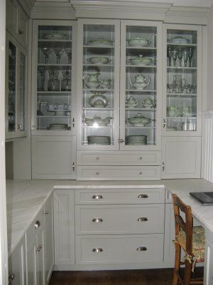 Butler's Pantry makeover by Willow Decor. Grey cabinets with glass, and marble counters.