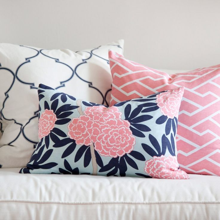 Summer Trends 2013: 60s Prep. Navy and pink preppy pillows in mixed patterns. The secret to mixing is to choose a color scheme, then a variety of prints: one large scale (the quatrefoil), a geometric (the pink bamboo), and a floral (notice the floral is not too dense of a pattern nor is it too loose with lots of negative space). Its all about finding balance and proportion.