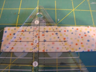 How to cut cloth hexagons with little waste and a great time-saver.