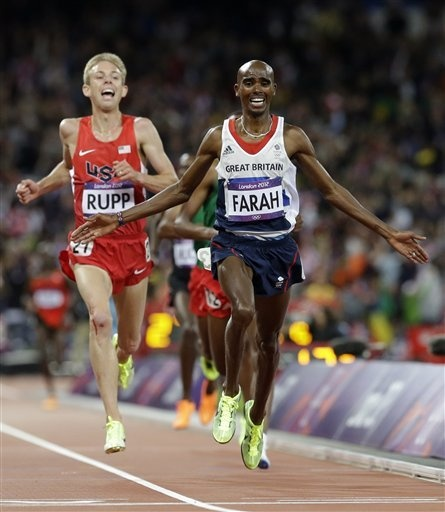 Britain's Mo Farah, right, crosses the finish line to win gold ahead of United States' Galen Rupp in the men's 10,000-meter final during the athletics in the Olympic Stadium at the 2012 Summer Olympics, London, Saturday, Aug. 4, 2012