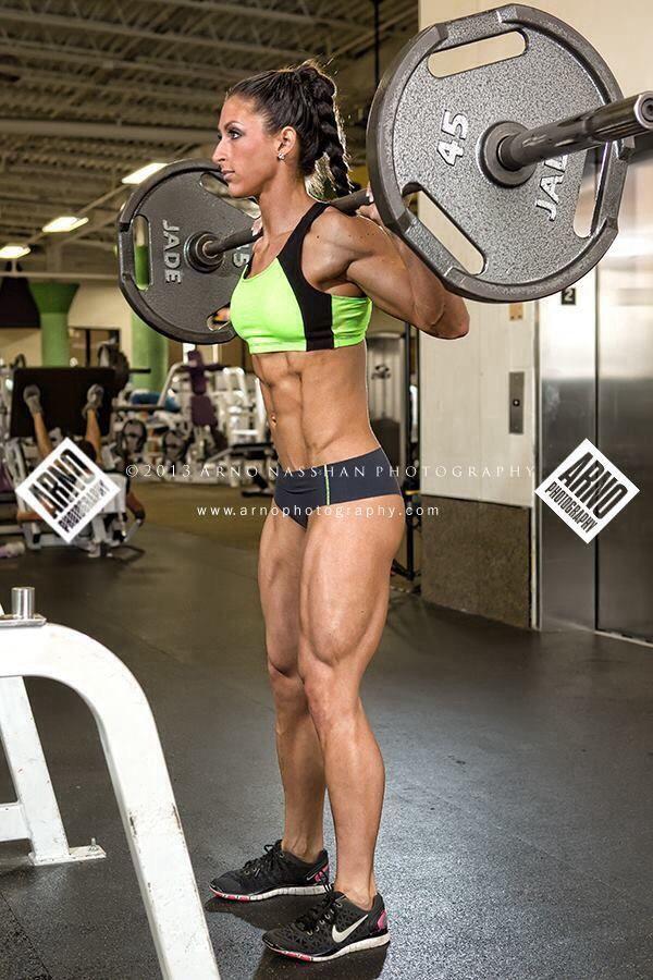 Female fitness model squats