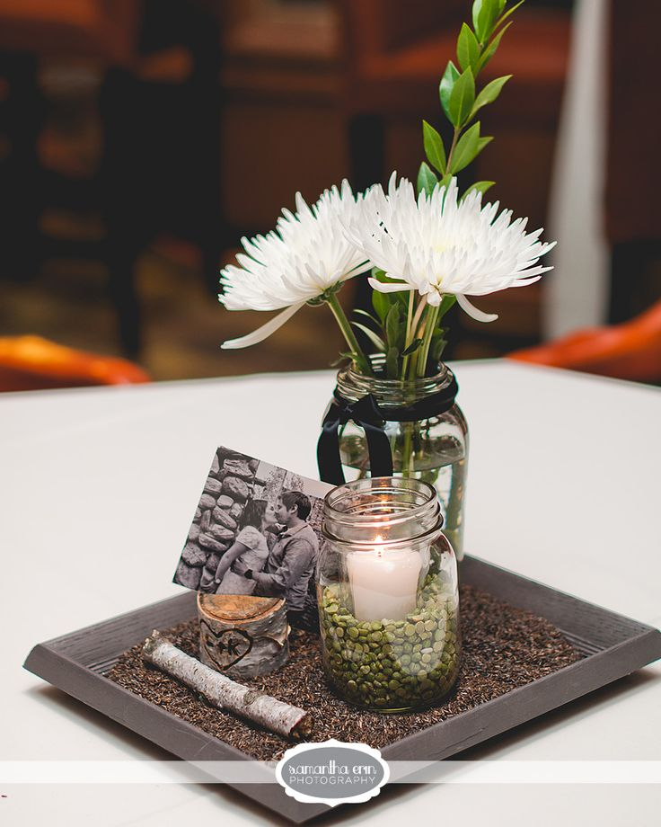 Earthy wedding decor! This is a great way to fill up space on tables, add diversity, color, creativity and make it distinctly your own while on a tight budget! The flowers pictured are white Spider Mums and a single branch of Myrtle.