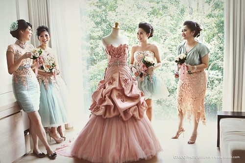 I love this photo with bridesmaids around the gown. Someone break out the dress form.  #DREAMWEDDING