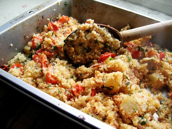 quinoa with roasted potatoes, tomatoes, garlic, and basil