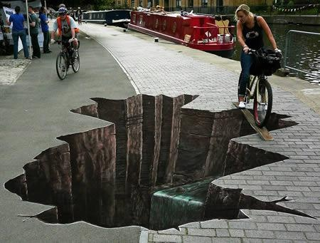 If you were riding a bike down this sidewalk and came across this mural would you steer around it or cross the board?