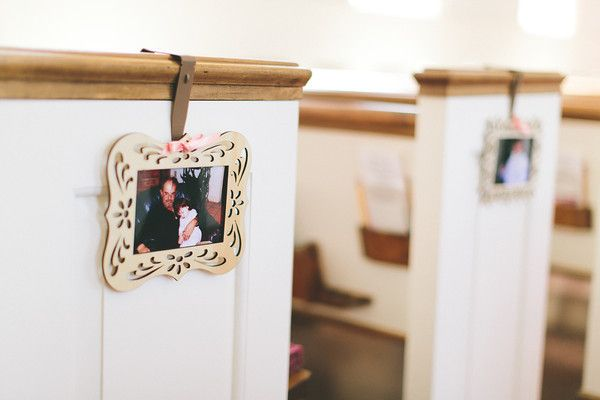 Pew-hangers had pictures of bride and groom growing up, starting with baby pictures in the back and growing older in each photo leading up the aisle, with our engagement photos in the pews right in front of the altar. His photos were on the groom's side, and hers were on the bride's side.