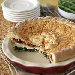 A savory deep dish pie with layers of ricotta, spinach, mozzarella, pepperoni and pizza sauce in a pizza dough crust.