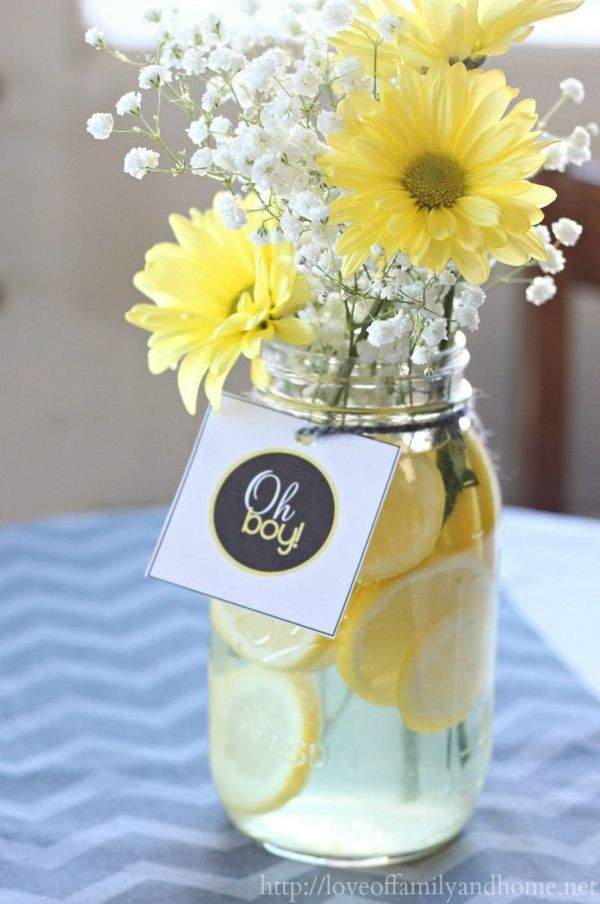 Gray & Yellow Baby Shower Decorating Ideas. Easy centerpieces with lemon slices, baby's breath, & yellow mum daisies. Cheap, easy, & beautiful.