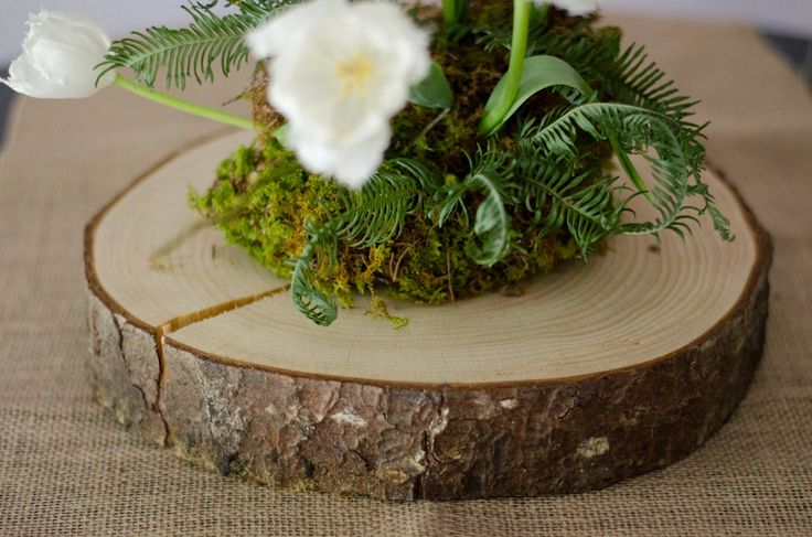 Moss and flowers on wood slab candles decor