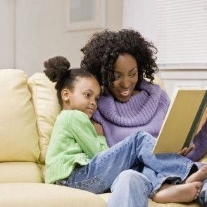 Mom reading books to child