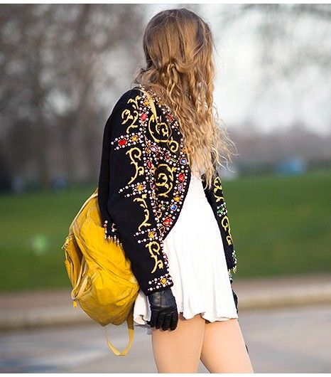 Make a fashion-forward style statement by teaming an embellished jacket with a bright bag.