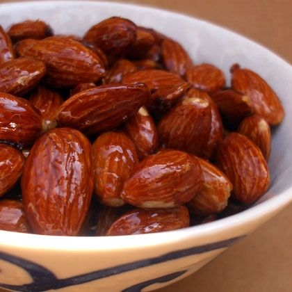 Maple-Glazed Nuts: almonds, syrup, parchment paper, oven