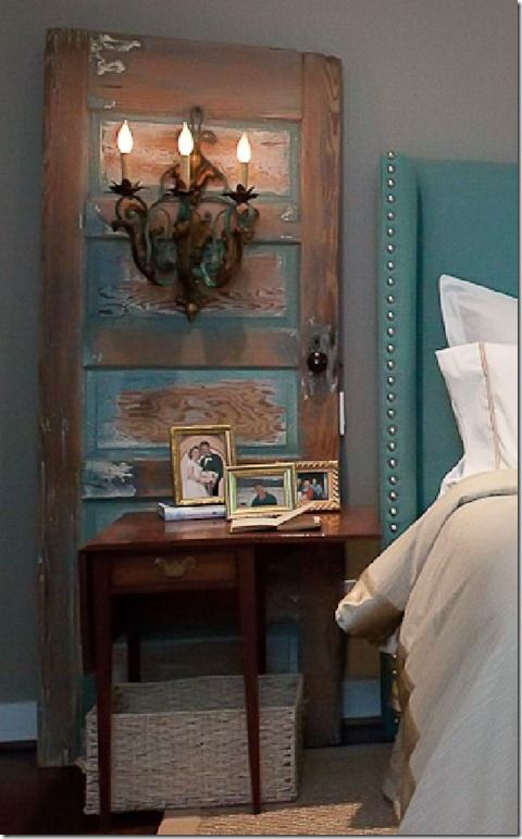 Sconces are attached to a salvaged door. This is a great way to add lighting & character to a room - you don't have to put holes in the wall & the door hides the wiring. Great option for renters.
