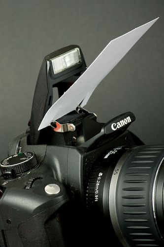 Use a business card or small white paper to bounce flash