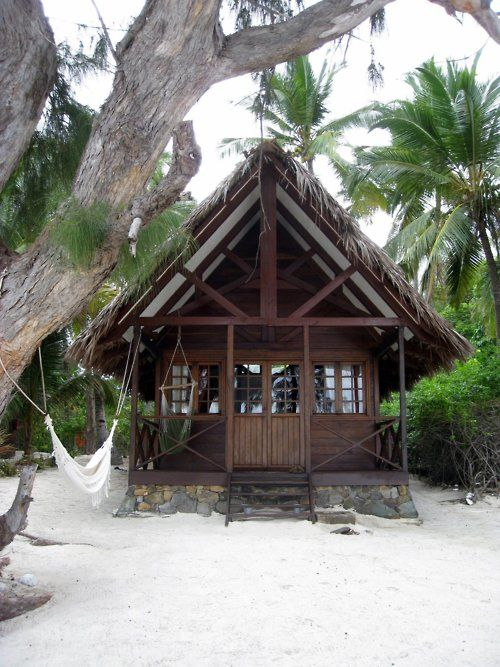 A beach cottage among the palm trees.
