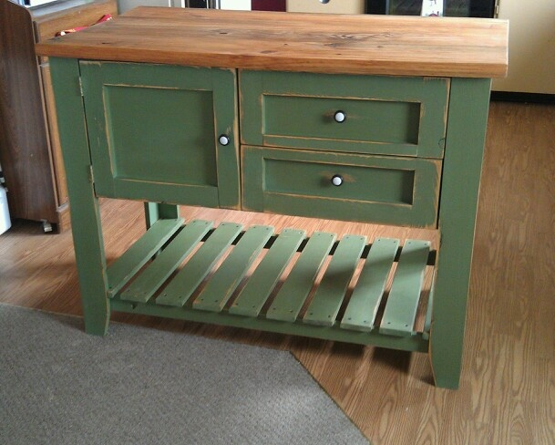 Beautiful spring green kitchen island with a rich mahogany counter top
