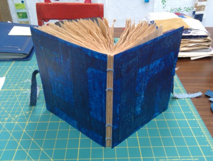 coptic stitched brown paper book