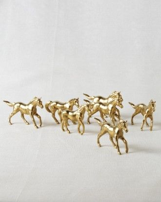 Though technically not favors, guests snatched up the gold horse figurines that decorated dinner tables at this glamorous Kentucky wedding.