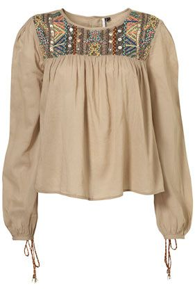Bohemian top with an embroidered neckline. #fashion #boho #beige #blouse