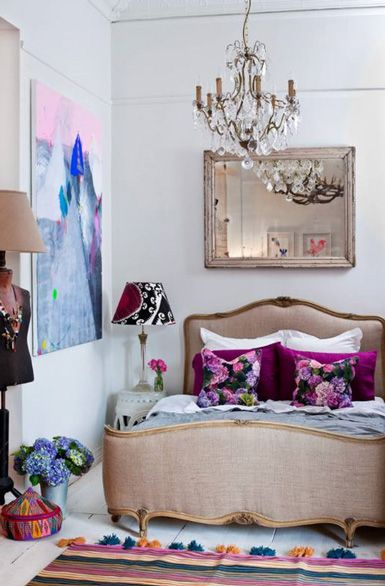 A pretty white bedroom with lots of brightly colored accents  (via belle maison)