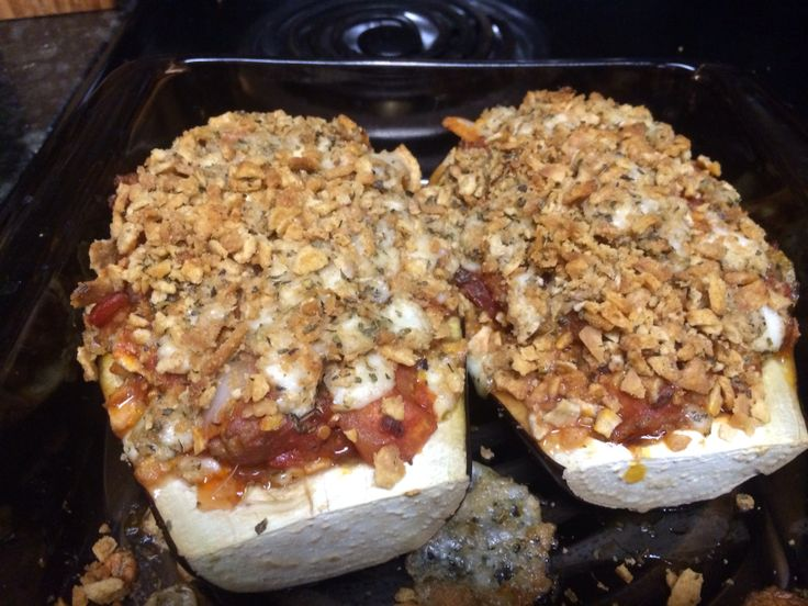 Stuffed eggplant with Italian sausage, zucchini and mozzarella. Scoop ...