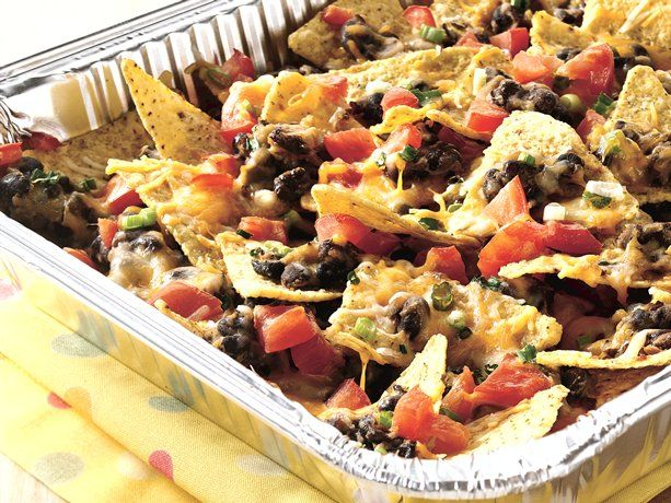 Grilled Picnic Taco Nachos take about 2 minutes to throw together, seal with foil and toss them on the grill. Excellent for entertaining - make up extra trays beforehand so they're ready to go. Serve with sour cream and guacamole. ♥ Betty Crocker
