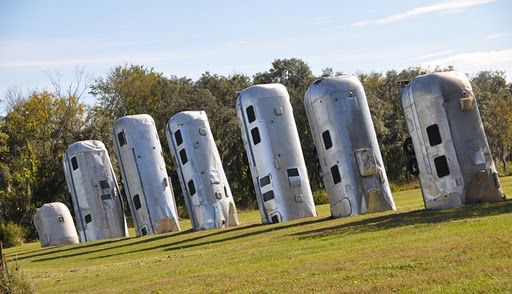 Eight silver Airstream mobile trailers shoved into the ground, tilting eastward at a roughly 20-degree angle like a stack of dominoes about to topple. It's creator Frank Bates has dubbed it Airstream Ranch, a homage to both Texas' Cadillac Ranch and Airstream