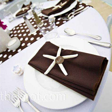 Brown and White Decor: Brown-and-white polka-dot table runners lined crisp white linens on the reception tables. Each white place setting was draped with a brown napkin and personalized starfish instead of escort cards.