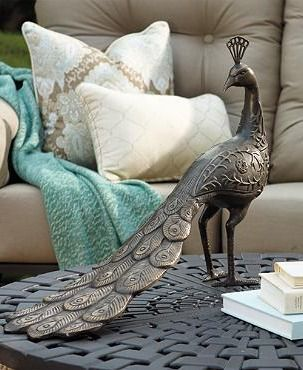 Our gloriously crested Brass Peacock peers over his shoulder to admire his length of well-detailed plumage- he's perfect for adorning an outdoor table or standing at a garden gate to greet guests.