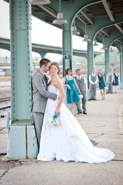 Groom & groomsmen in gray  Bridesmaids in teal  Bride in white :)
