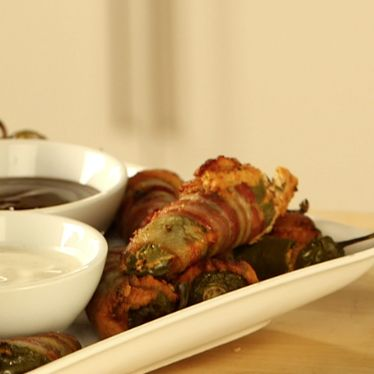 Bacon-wrapped jalapeno poppers are a must-have at your next party!